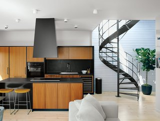 These 5 Transformations Show Why Challenging Renovations Are Worth It - Photo 5 of 5 - Maria Rosa Di Ioia and Emilie Bédard, nudged a fairly small Montreal row house into a bright, open program. The design team understood what to leave alone (the brick) and what to add (a rooftop pavilion with a custom sauna).