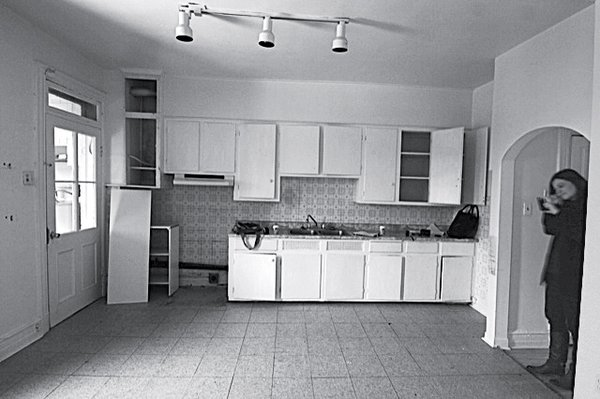 The apartment originally crammed four closed rooms and a kitchen and bathroom into 1,000 square feet. After the renovation, it had only one bedroom and a large, open kitchen.