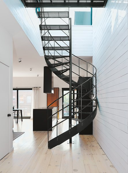 Di Ioia and Bédard designed the wrought-iron spiral staircase that leads to the rooftop terrace and sauna as a visual nod to Montreal's signature outdoor stairways.