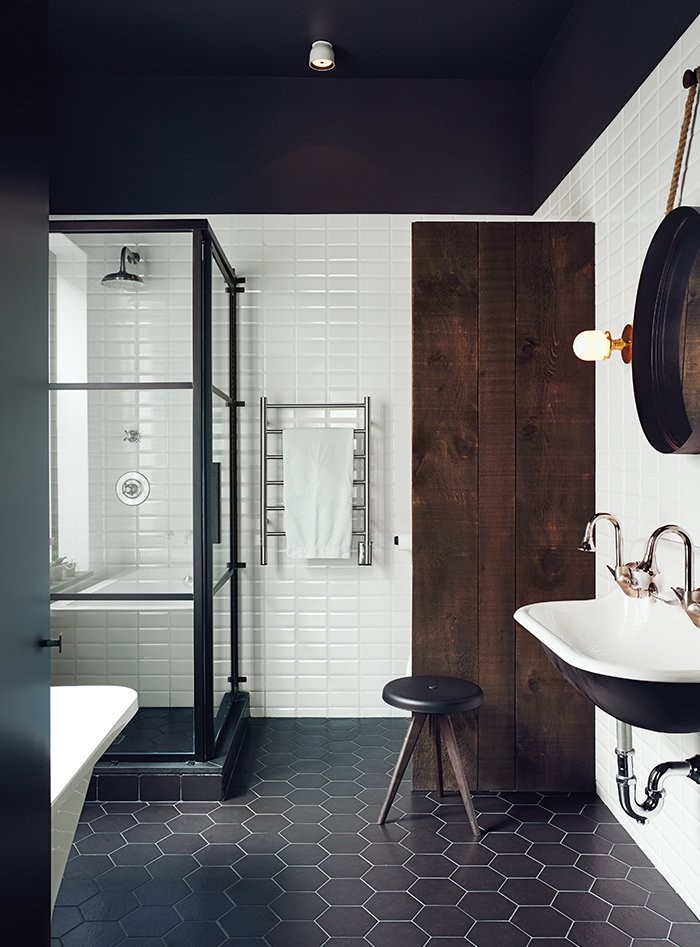 In the master bath, a dowdy tub was replaced with a standing shower designed by Di Ioia and Bédard and manufactured by Linea P International. The wall and floor tiles are by Ceragres, and the sink, tub, and towel rack are by Aqua Mobilier de Bain. Tagged: Bath Room, Enclosed Shower, Wall Mount Sink, Ceramic Tile Floor, Subway Tile Wall, Freestanding Tub, Ceiling Lighting, Corner Shower, and Wall Lighting.  Photo 2 of 13 in 12 Creative Ways to Use Tile in Your Home from Scandinavian Style Revives This Montreal Home