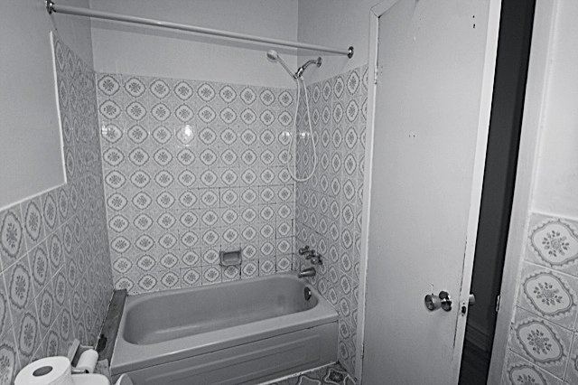 A before shot of the bathroom.  Photo 8 of 14 in Scandinavian Style Revives This Montreal Home