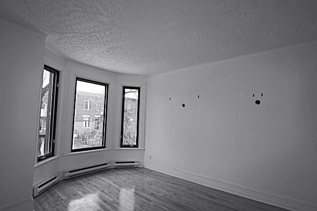 The same space before it was updated.  Photo 10 of 14 in Scandinavian Style Revives This Montreal Home