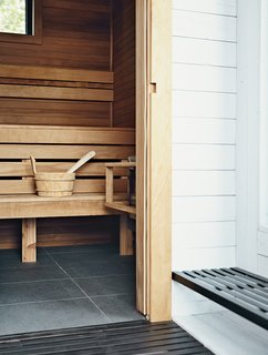 Scandinavian Style Revives This Montreal Home - Photo 13 of 14 - Torrified cedar lines the inside of the rooftop sauna.