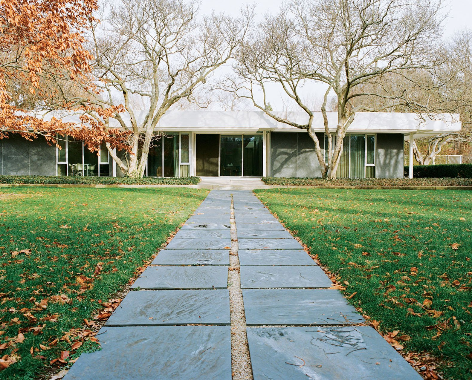 Eero Saarinen's legendary Miller House opened to the public in May 2011 for the first time. The pathway from the pool to the house is paved with the same slate that clads the exterior walls. Photo by Leslie Williamson.