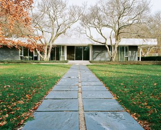 20 Modern Homes From the Midwest - Photo 5 of 20 - Eero Saarinen's legendary Miller House opened to the public in May 2011 for the first time. The pathway from the pool to the house is paved with the same slate that clads the exterior walls.