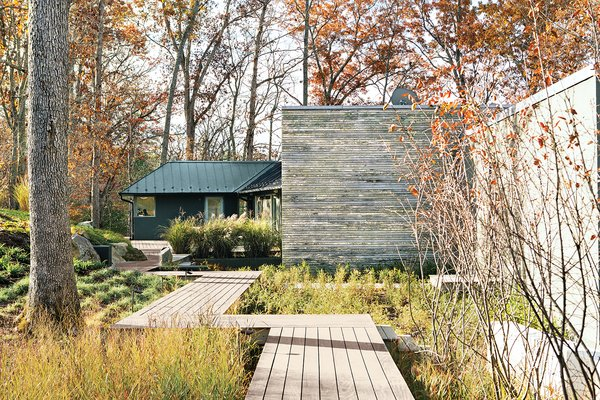 The landscape design, by Anna Boeschenstein of Grounded, followed a 2,200-square-foot extension by Formwork architects Robert and Cecilia H. Nichols. The front door is painted in Chinese Red by Sherwin-Williams.