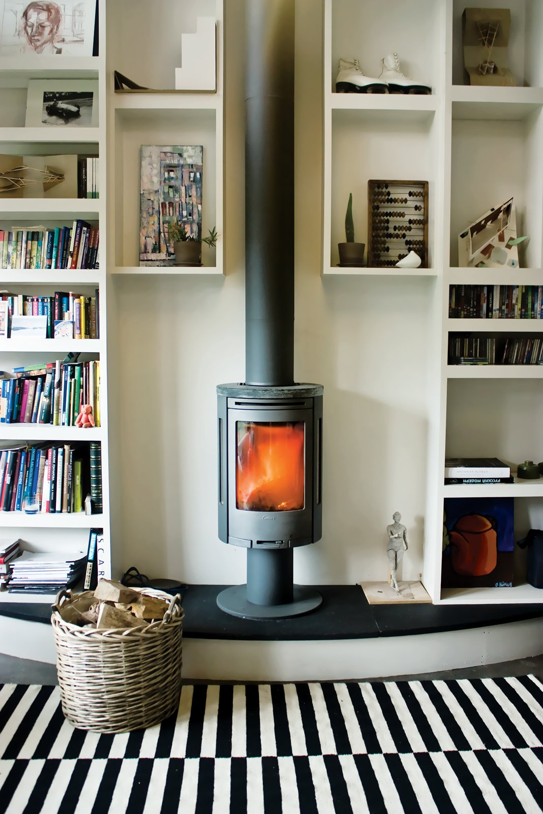 SOCIAL HEAT  What's the best way to warm a small studio? Ekaterina Voronova opted for a compact wood-burning stove to keep her space cozy.  Modern Wood-Burning Stoves by Megan Hamaker from Social Heat