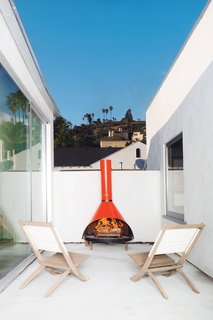 The Modern Renovated Home of Glee Star Jayma Mays - Photo 7 of 13 - A fireplace found at the Rose Bowl Flea Market furnishes another of the new deck spaces.