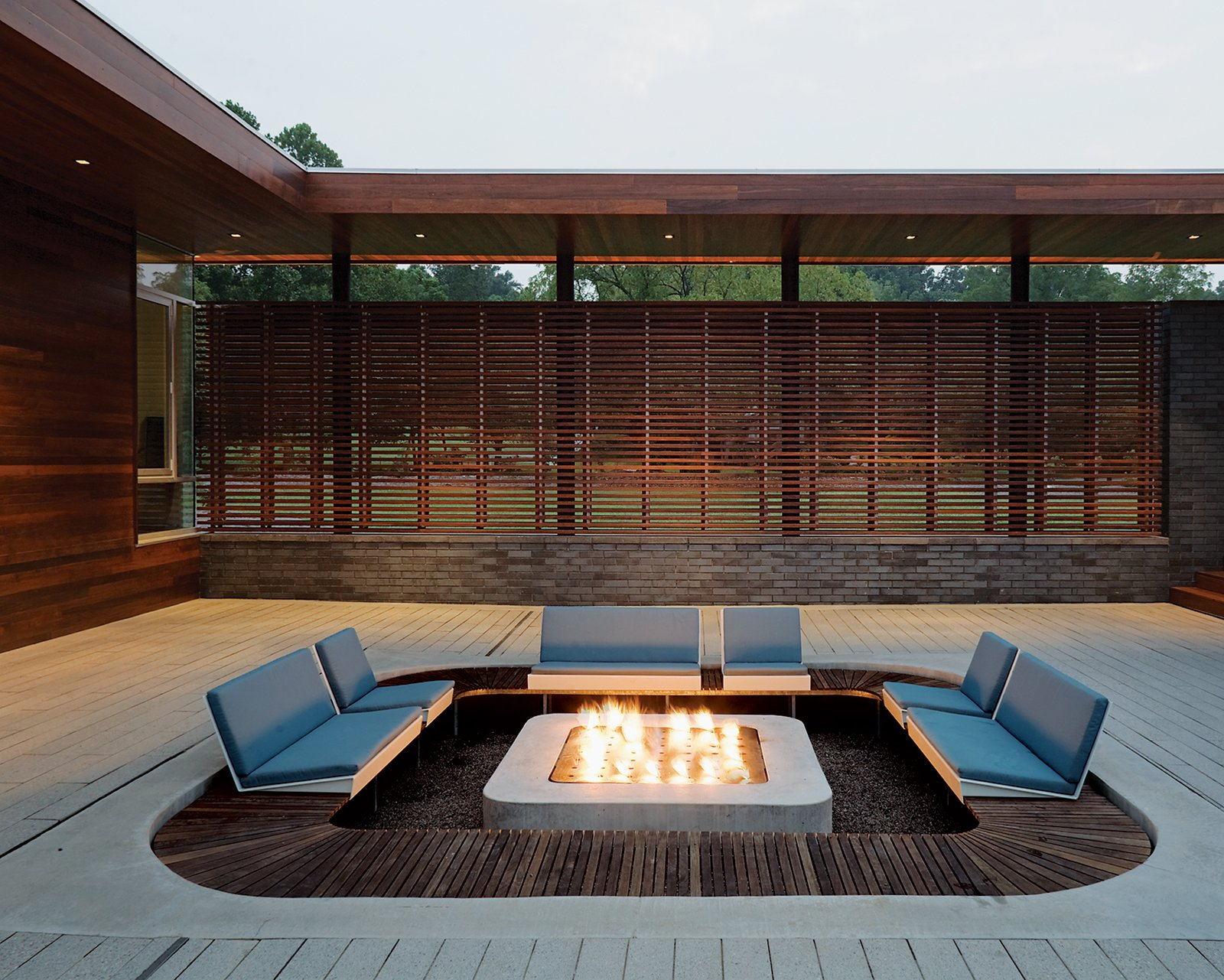 """We didn't want the pit to be an obtrusive contraption sitting in the center of a zen-like courtyard,"" says architect Matthew Hufft. A low-profile fire pit is the perfect continuation of a mellow Missouri backyard. Photo by Mike Sinclair.  97+ Modern Fireplace Ideas by Dwell from Sunken Outdoor Fire Pit"