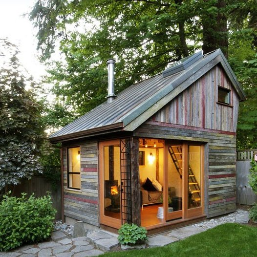 Megan Lea built a backyard retreat with reclaimed materials figuring prominently into the design. What resulted is a polychrome of salvaged 100-year-old barnwood by West Salem-based Barnwood Naturals that makes the facade of this Bernard Maybeck-inspired design as unique as it is environmentally friendly.  One-Room Wonders by Luke Hopping from Fantastic Backyard Buildings