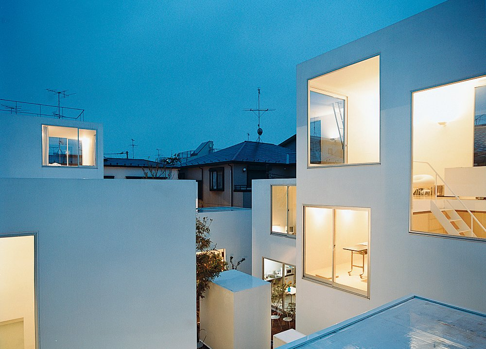 The compound at dusk.  Modern Homes in Tokyo by William Harrison from Bold Japanese Houses