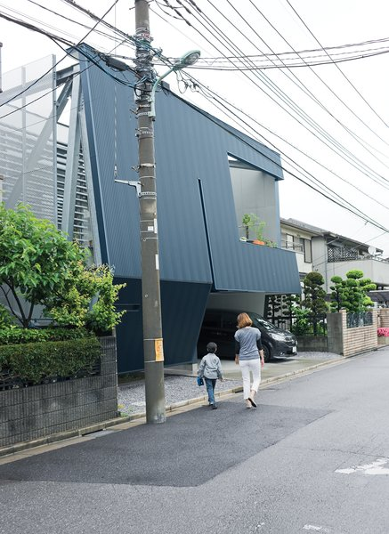 """Everyone stops to look at the building,"" says Motoshi. Neighbors may stare at the severe facade, but once inside they are amazed with the quality and comfort of his home. Its efficient design comes from IDEA Office's clever rethink of local zoning regulations and required setbacks."