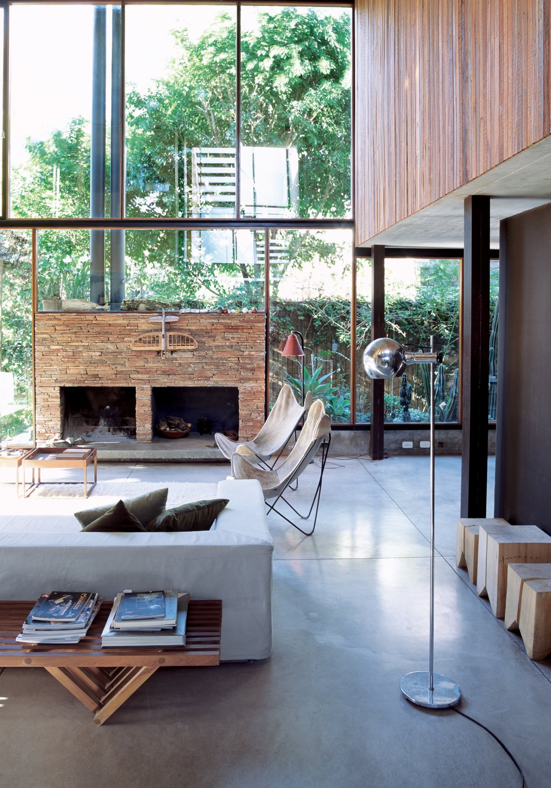 The living room resembles a Sticotti furniture showroom: The architect designed the couch, coffee tables, and stumplike stools. The fireplace is made of stacked stone from San Juan, a nearby province. 20 Modern Living Rooms - Photo 7 of 20