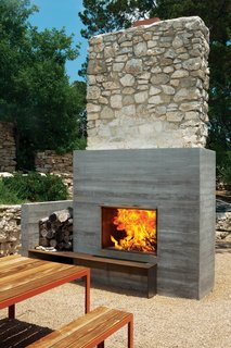 Texas Two-Step - Photo 1 of 2 - The outdoor fireplace of the Balcones house designed by Elizabeth Alford.