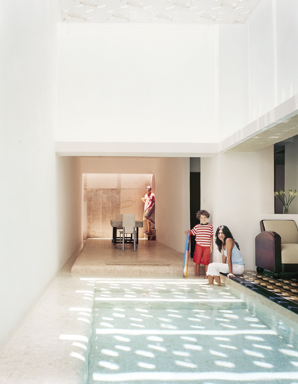 The dining area feels like an extension of the pool, with water channels on two sides. 12 Perfect Plunge Pools For Your Small Outdoor Space - Photo 8 of 13
