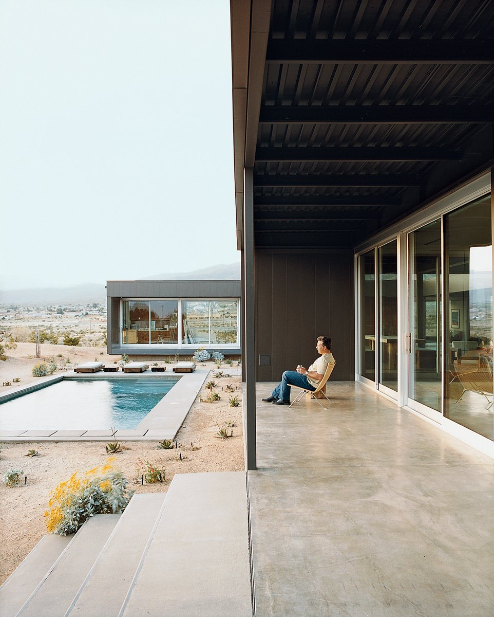 Composed of primarily steel, this prefab home has sufficient outdoor space. Photo by: Daniel Hennessy Tagged: Concrete Pools, Tubs, Shower, Large Patio, Porch, Deck, Back Yard, Large Pools, Tubs, Shower, Desert, Exterior, and House.  Photo 1 of 23 in 20 Desert Homes from Modern Swimming Pools