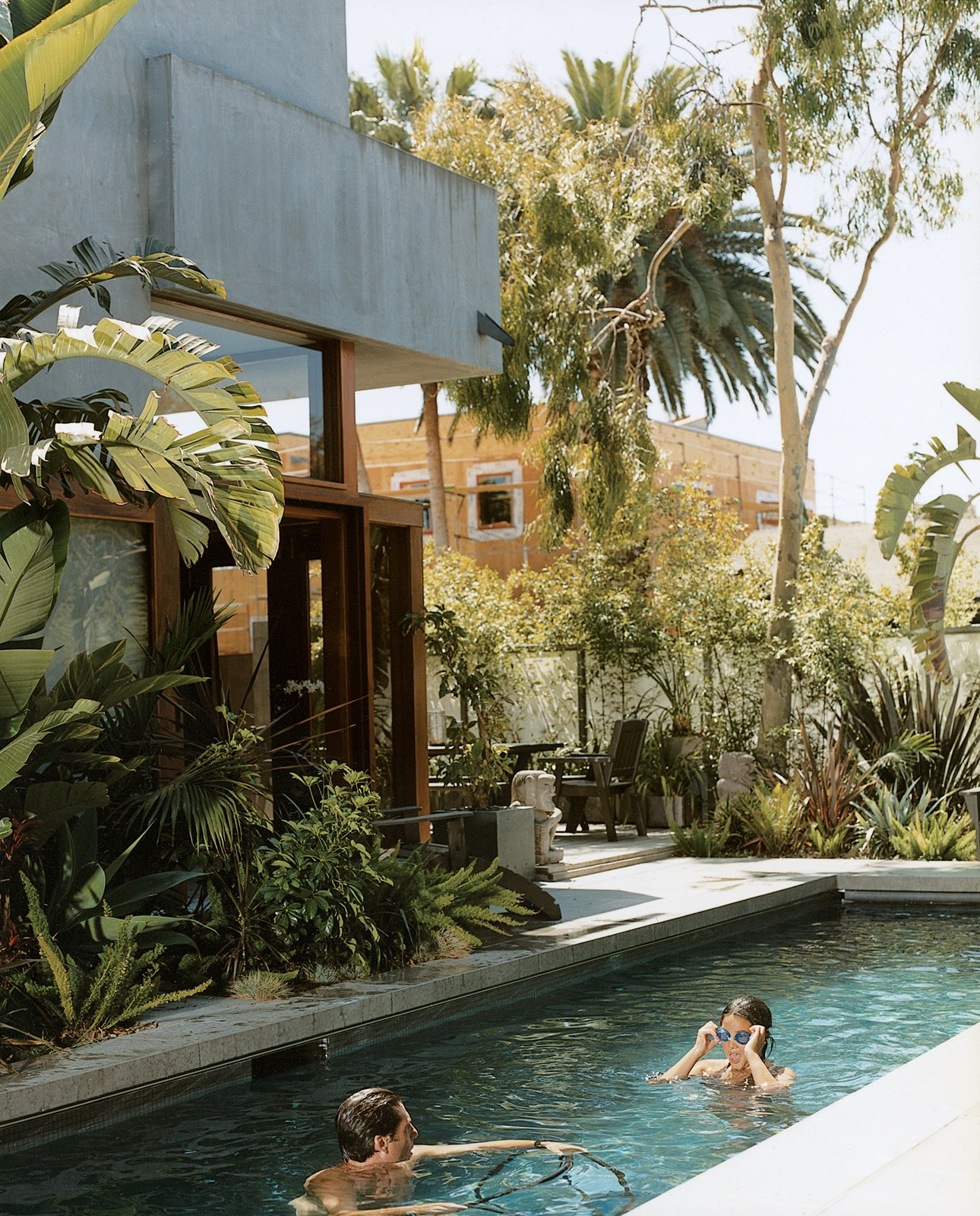 Sophie and Colin enjoy their new pool, the only non-solar-powered portion of their home in Venice, California, created by their father, architect David Hertz. Read the full article here. Plants by Nikki Webster