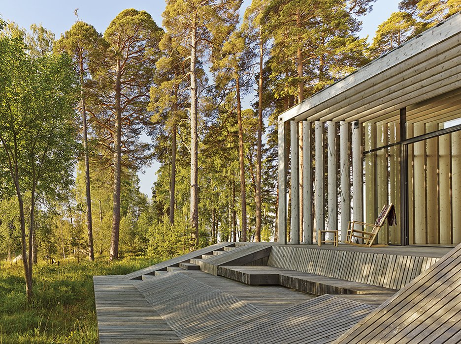 The wood on the exterior has been treated with linseed oil or painted with tar. Seats built directly into the pavilion's frame allow the family to relax and enjoy the surrounding woodlands without the need for additional furniture. How a 1,000-Year-Old Technique Made This Pavilion - Photo 7 of 8