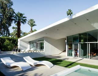 An Energy-Efficient Hybrid Prefab Keeps Cool in the Palm Springs Desert - Photo 5 of 12 - Cloe chaise longues from Myyour surround the pool.