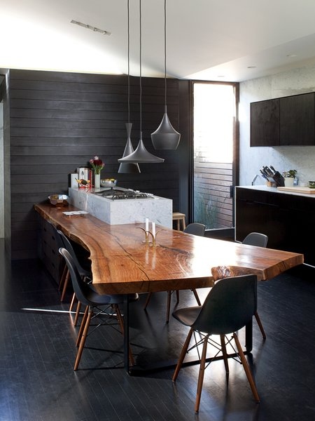 "The materials palette is similarly restrained, making the only natural piece of wood in the house—the almost 14-foot-long walnut slab in the kitchen—really stand out. ""If there was wood everywhere it would lose its gravitas,"" notes Chris."