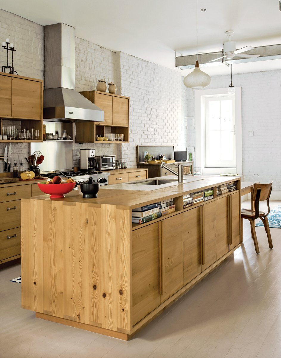A family enlists Brooklyn design-build firm MADE to renovate a brownstone using surplus and salvaged materials for a budget-conscious patina. In the kitchen, the island and cabinets, fashioned from remilled Douglas-fir beams salvaged from upstate New York, sport inexpensive drawers from Ikea.