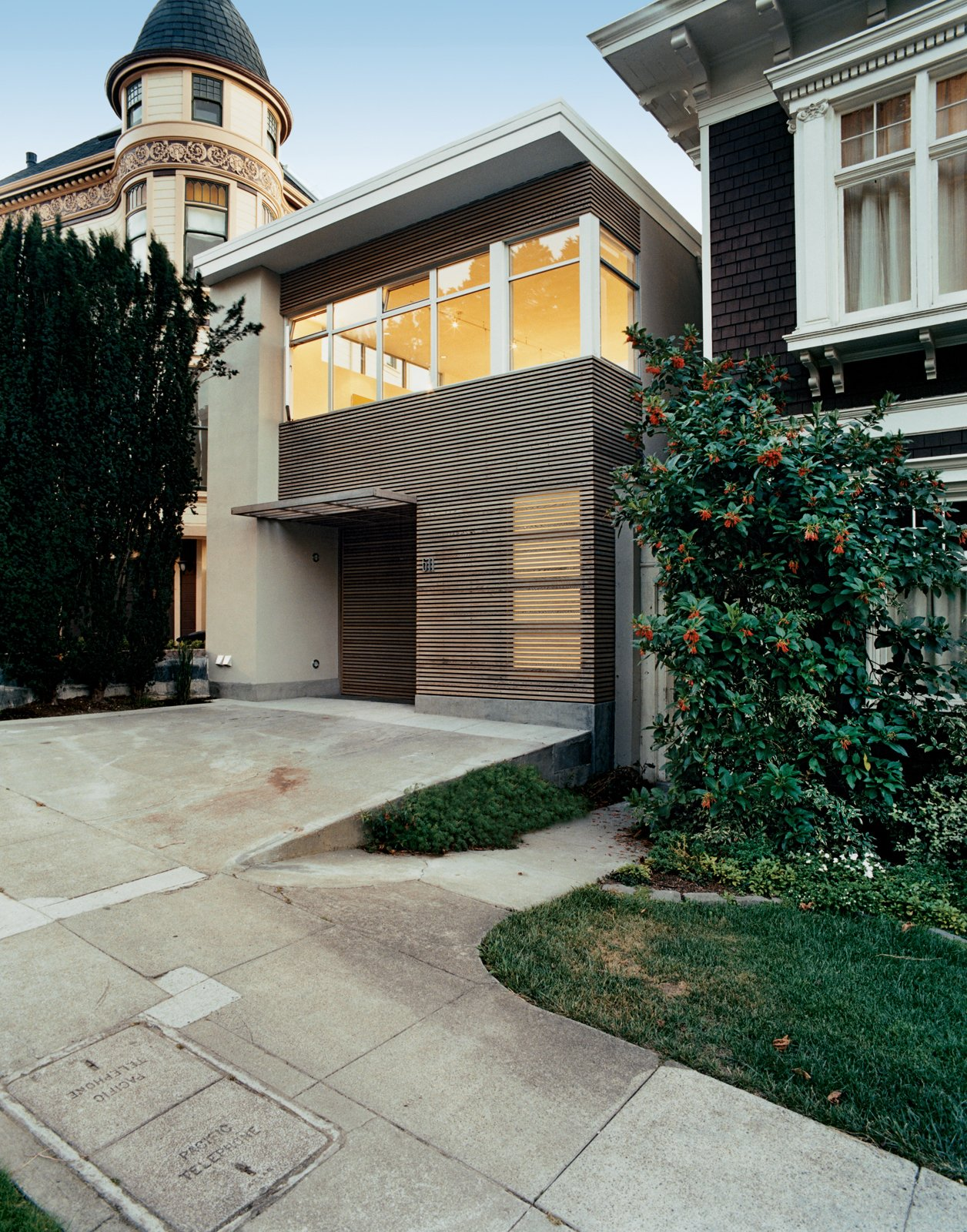 The housees that circle San Francisco's Buena Vista Park run the gamut from wedding-cake Victorian to Scandinavian modern. Architect Cass Calder Smith aimed to create a façade that contextually relates to the adjacent ornate ones yet is purely modern. Tagged: Exterior, House, Wood Siding Material, and Flat RoofLine.  Photo 3 of 9 in Standout in a Crowd