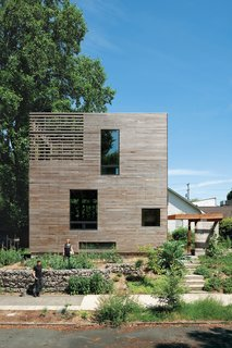 A basic box that's as tall as it is wide (28 feet) and 16 feet long, this Portland, Oregon house consists of rooms stacked vertically: an unfinished basement on the bottom, a kitchen-living area and a bathroom in the middle, and a bedroom on top, with the stairwell hinged onto the front of the home. The only interior doors are those to the bathroom, basement, and root cellar, leaving the rest of the space open and unfettered. At just 704 square feet, Katherine Bovee and Matt Kirkpatrick's home is a great lesson in making the most out of every inch. Click here to see the interior.