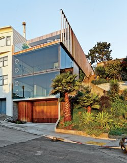 Mechanical engineer Jan Moolsintong and industrial designer Peter Russell-Clarke enjoy epic views of San Francisco from their 1,800-square-foot house overlooking the Mission District. The distinctive facade has operable porthole windows and a slatted garage door that was custom-built by Raimundo Ferreira.