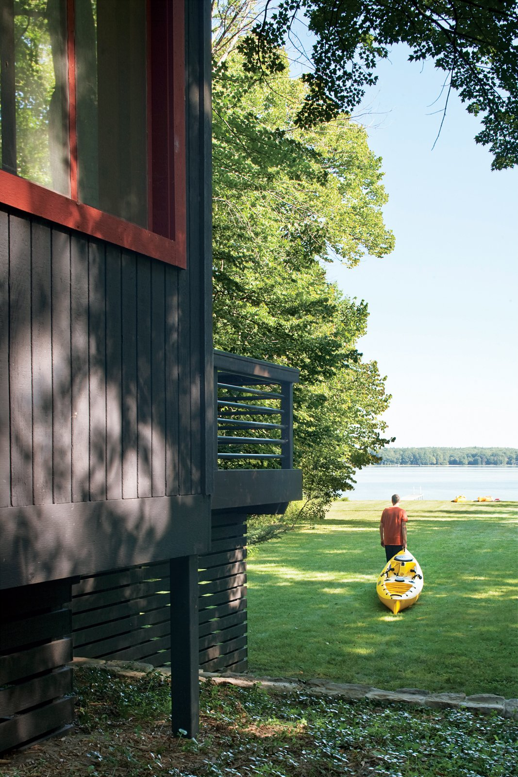 The cottage sits on an acre of mature trees, with a sloping lawn stretching to the pebbly shore of the inland lake. The Campbells regularly drag their kayaks down to the water's edge and set off toward the deeper waters of Lake Michigan.  Photo 12 of 12 in Campbells' Coup
