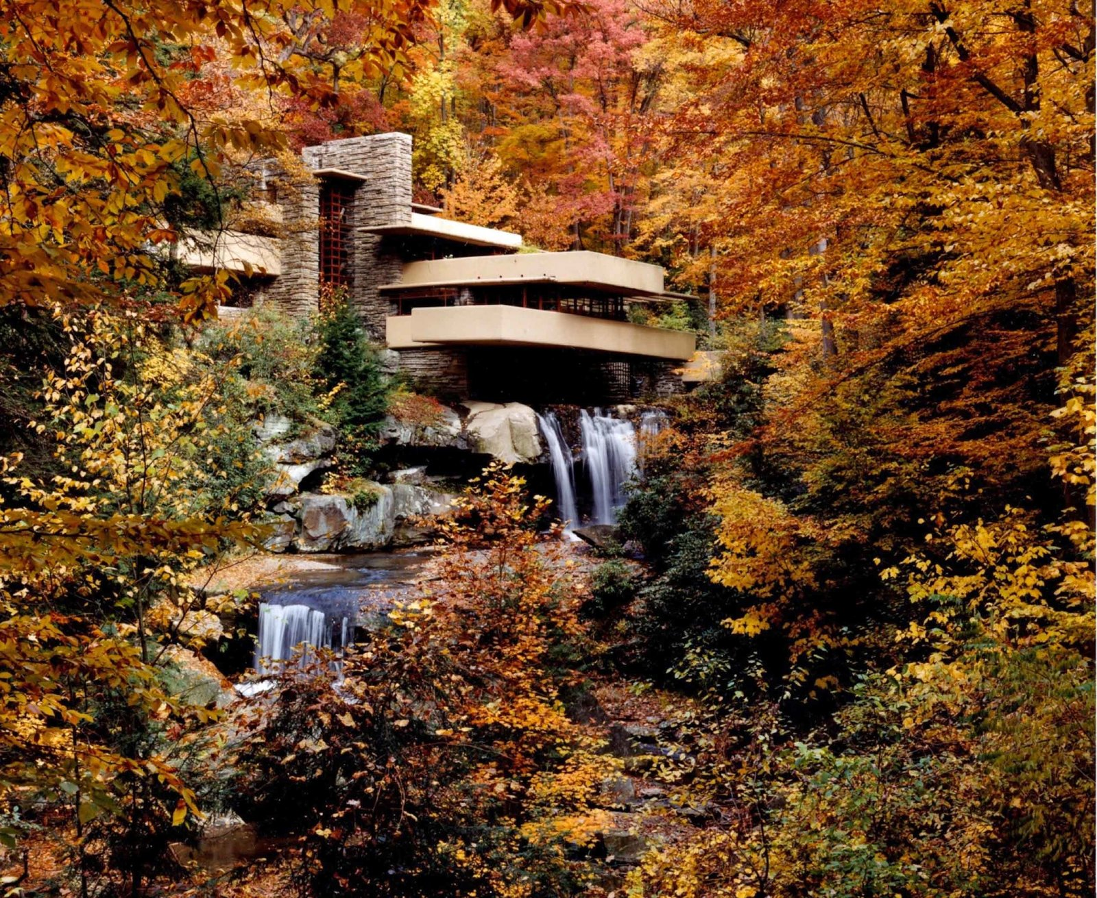 Fallingwater (1935, Mill Run, Pennsylvania). The legendary Fallingwater residence, a masterpiece in concrete, steel, and glass, is built with three levels that project over a 30-foot waterfall.  Iconic Frank Lloyd Wright Buildings by Allie Weiss