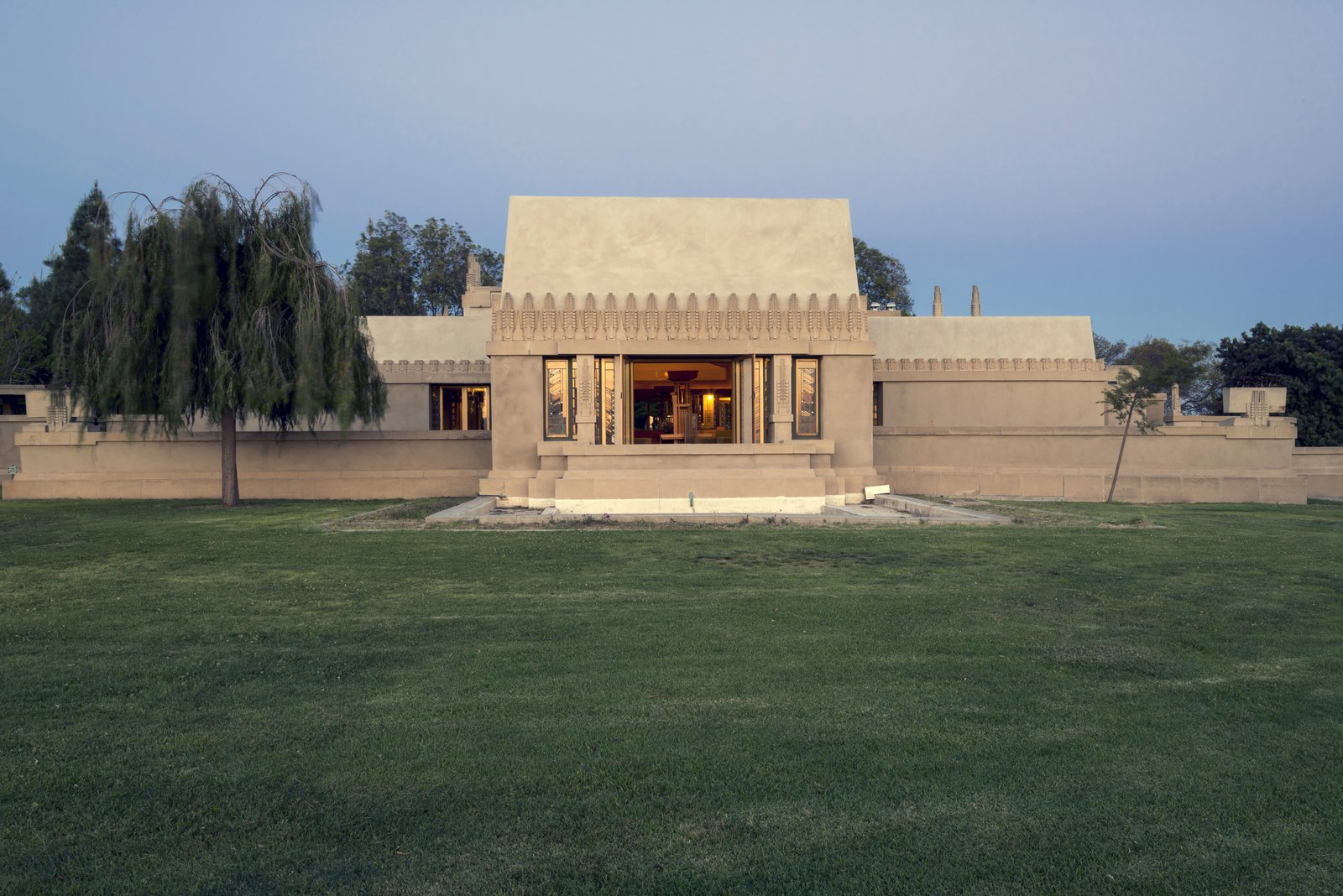Hollyhock House (1918, Los Angeles, California). This residence, the architect's first commission in Southern California, revolves around a central patio and contains multiple rooftop terraces.