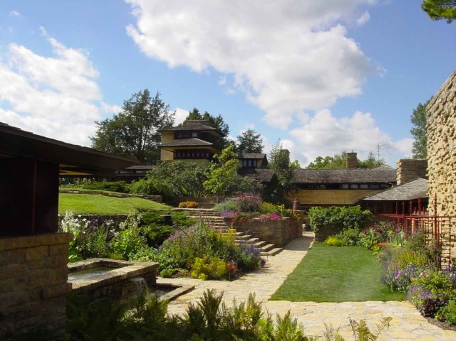 Taliesin (1911, Spring Green, Wisconsin). Wright's home and studio, rebuilt after two fires, is a peaceful retreat that demonstrates the architect's graceful merging of architecture and landscape.  Iconic Frank Lloyd Wright Buildings by Allie Weiss