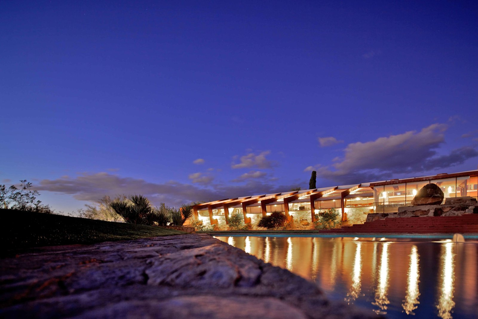 Taliesin West (1938, Scottsdale, Arizona). Wright experimented with architectural techniques on his winter home and studio over the course of two decades. He developed a stone masonry out of boulders and rocks found around the site. The property houses the offices of the Frank Lloyd Wright Foundation; the resident staff and students who live and work at Taliesin and Taliesin West; and the Frank Lloyd Wright School of Architecture.  Mid Modern by Jonathan Simcoe from Iconic Frank Lloyd Wright Buildings