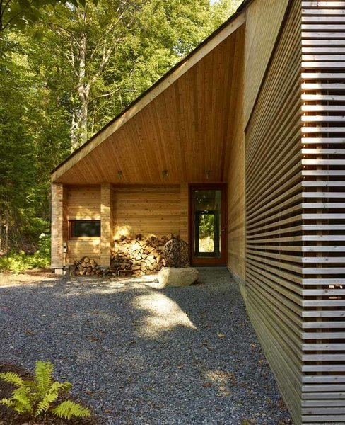 Using wood as the primary building material imbues an aesthetic warmth to the structure. It's also cost-effective, considering the abundance of Canada's natural timber resources and strong local carpentry trade. Photo by Shai Gil. Photo 2 of Stealth Cabin modern home