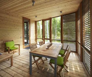10 Enclosed Porches That Are Put to Good Use - Photo 10 of 10 - Walls and ceilings fold like origami, sheltering the interior with tent-like flaps. In the enclosed porch, horizontal slats is palatable for a traditionalist, thanks to generous use of cedar.