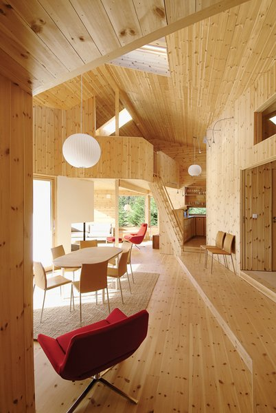 The double-height ceiling and knotty interior give the Cabin Nordmarka a pleasant lightness, despite being situated deep in the Norwegian forest. Photo by Nils Petter Dale.