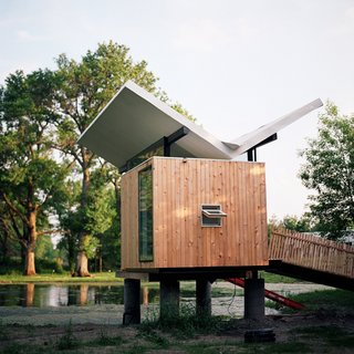 20 Modern Homes From the Midwest - Photo 1 of 20 - Designed by architect Jeffery Poss, the tea hut is the first of what Kalanzis and her husband, Bill Cope, hope to be several sculptural structures on their property, which comprises a forested grove to the east, a former tree farm on the west, and the main house and hut in the middle.
