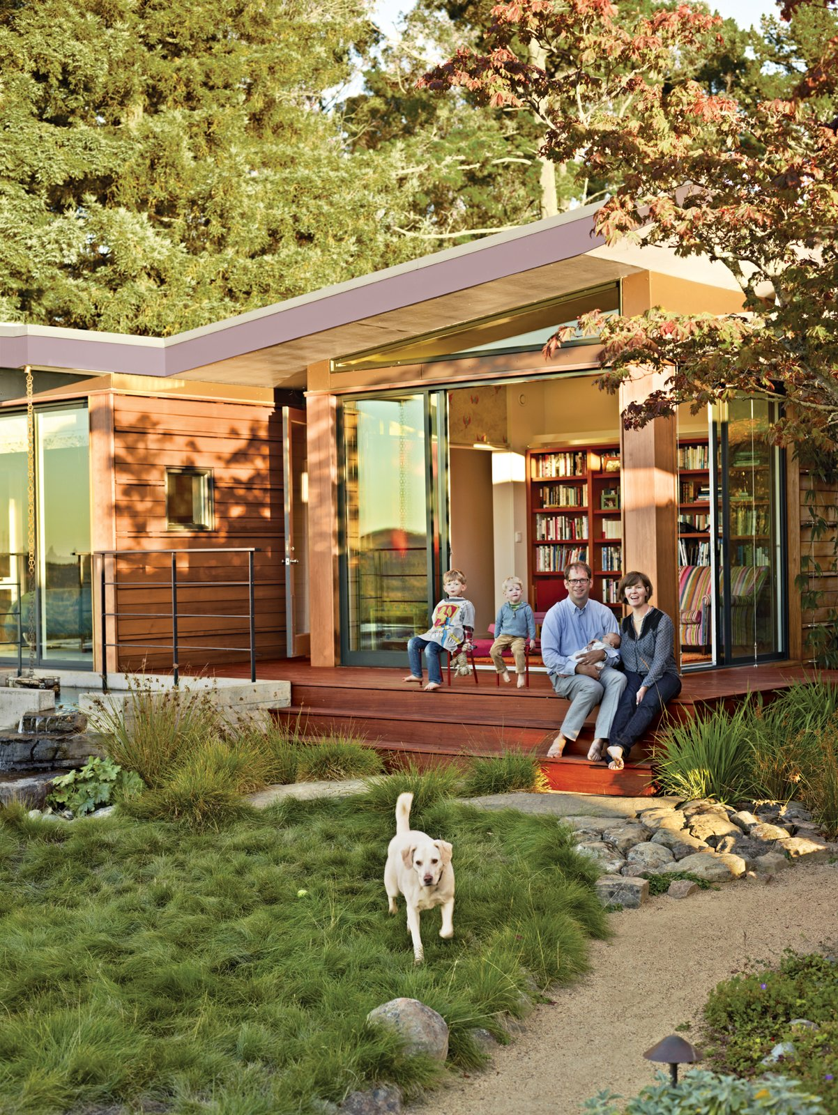 In need of more room for their growing brood, Eric and Emma Gimon, with Luc, Paul, baby Louise, and their dog, Nefi, asked for a private space to accompany the house designed for Eric's great-aunt. Tagged: Exterior, Prefab Building Type, House, Cabin Building Type, and Butterfly RoofLine.  Photo 16 of 25 in Leap Into the Year of the Dog With These 25 Pups in the Modern World from A Modern Prefab Addition to a Mid-Century California Classic