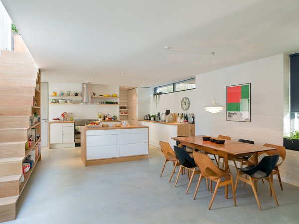 A wider look at the open-plan dining room and kitchen.