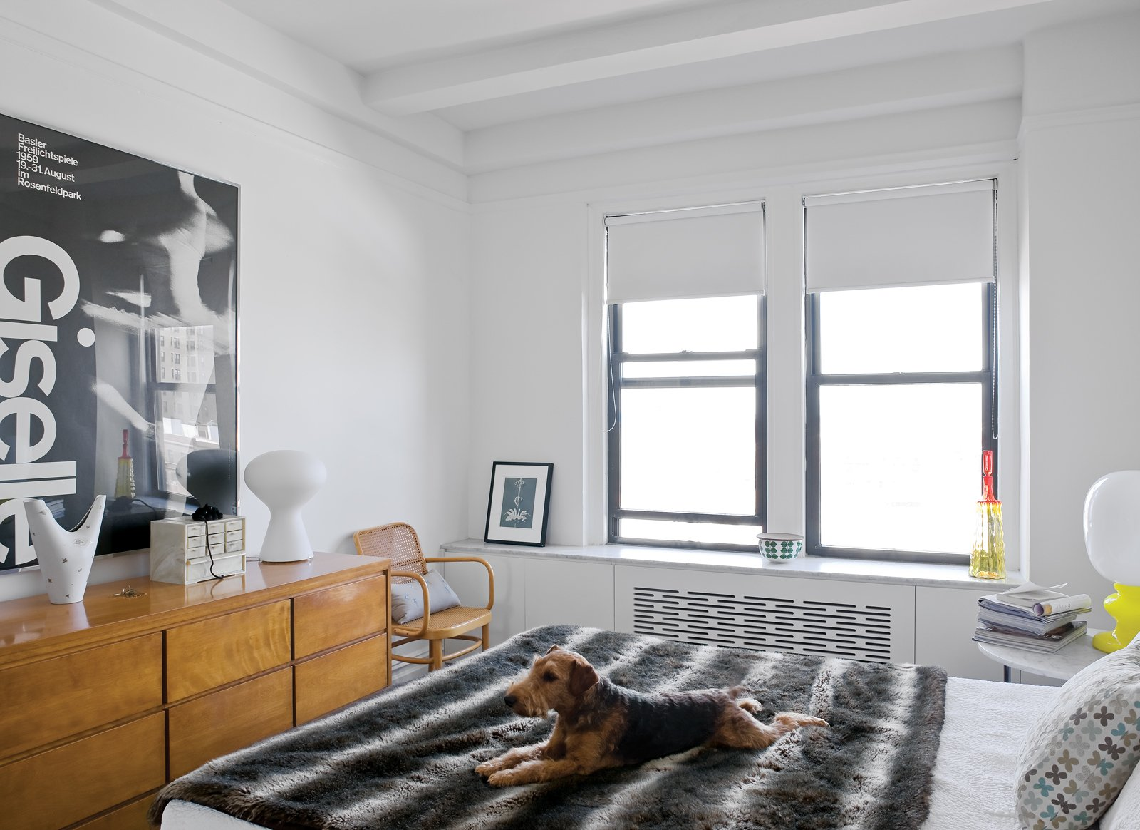 Beneath the windows in the living room and the bedroom is the clever built-in radiator screen/storage system designed by Joshua Pulver and Mike. The bedroom dresser is vintage Russel Wright. Tagged: Bedroom, Bed, and Dresser.  Inside 7 Modern Renovations in Brooklyn by Aileen Kwun from Creative Renovation in Brooklyn