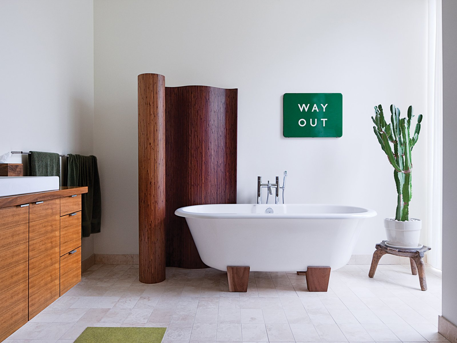 the master bathroom has a bamboo screen and a deauville tub by victoria albert: dwell bathroom cabinet