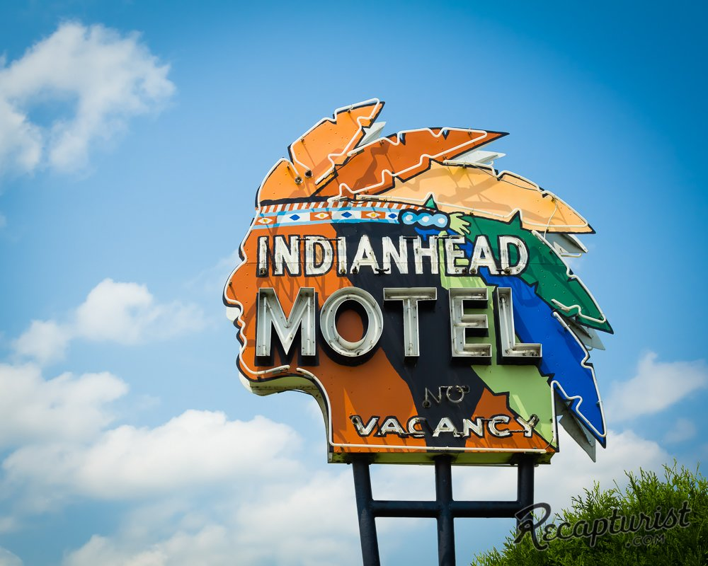 """One of Rose's favorite signs belongs to the Indianhead Motel in Chippewa Falls, Wisconsin. """"The colorful headdress on this one—repainted as recently as 2008—is even more stunning in person,"""" he says. """"Thanks to help from the local historical society, I was able to trace its origins back to 1958 when a man named Ernest Cote first opened the motel."""""""