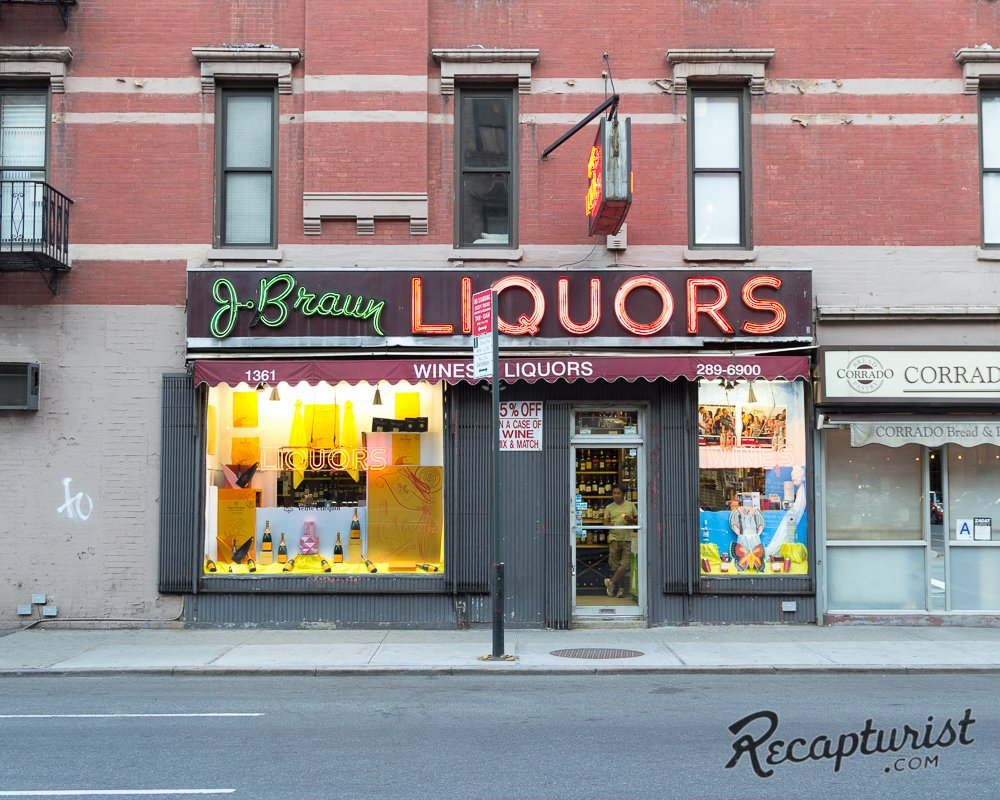 """In addition to signs, Rose documents storefronts, like J. Braun Liquors in New York City. """"Julius Braun was a Jewish immigrant who arrived in the United States from Poland with his family in 1921,"""" he writes. """"He was only seven years old at the time. City records indicate that the neon signage was installed in 1952. When Mr. Braun passed away in 1995, the store was sold to new owners who, despite changing the business name to 'Uptown Wine Shop', never updated the signage out front. No complaints here."""""""