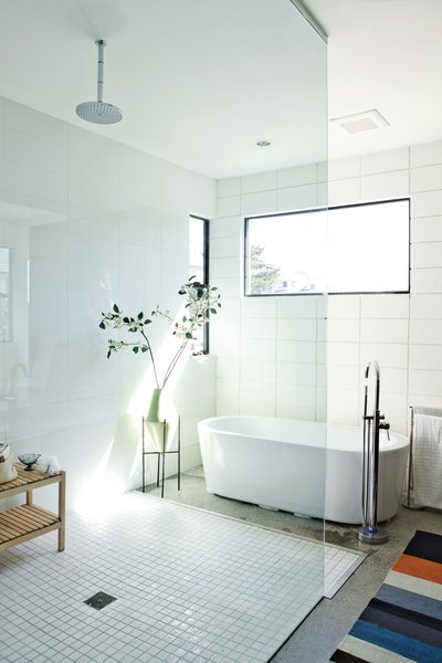 Part of a 1,000-square-foot space the brothers designed for their parents, the master bath features a Whittington Marlon bathtub from Signature Hardware.