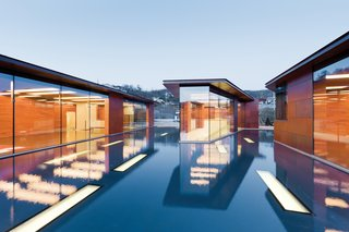 Clad in copper panels that Holl had fabricated by the Kansas City, Missouri, company Zahner, the house is daylit by a host of rectangular skylights (inspired by the musical staff) punched through the roofs and the pool's floor.