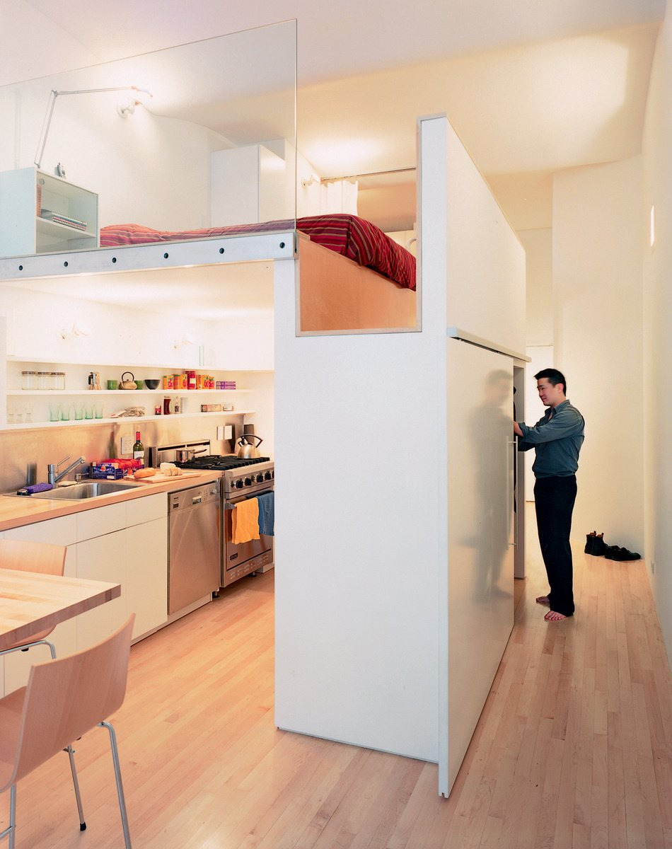 Raising the bed above floor level, architect Kyu Sung Woo converted this tiny studio into an open and comfortable home for Wonbo Woo. Photos by: Adam Friedberg Tagged: Storage Room, Closet Storage Type, and Under Stairs Storage Type.  Loft by Chris Cole from Tiny Kitchens We Love