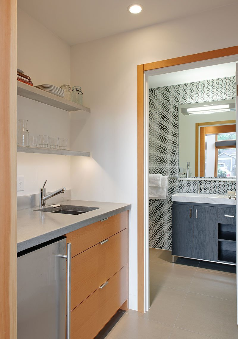 The kitchenette countertops are made from recycled concrete. The bathroom tile is by Pental. Tagged: Bath Room and Marble Counter.  Best Photos from Garden Pavilion, Seattle