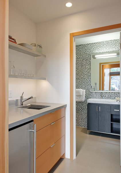 The kitchenette countertops are made from recycled concrete. The bathroom tile is by Pental.