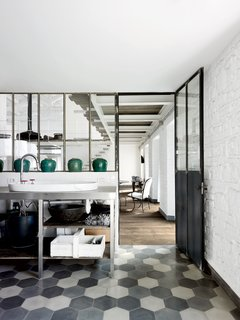 Paola Navone's Industrial Style Renovation in Italy - Photo 3 of 11 - For the floors in the kitchen and throughout, Navone placed hexagonal Carocim tiles of her own design.