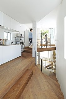 The top of the house is dedicated to a dining area and a kitchen outfitted with steel-topped cabinets from Sanwa Company.